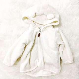 White furry jacket