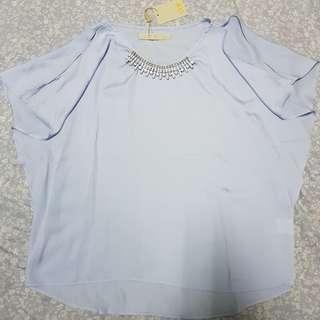 CLN light blue blouse with slits or cold shoulder