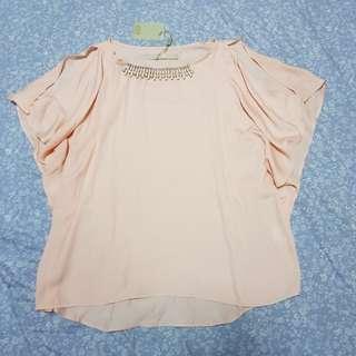 CLN Orange blouse with slit or cold shoulder