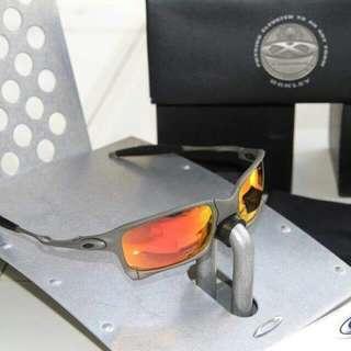 X metal Oakley sunglasses