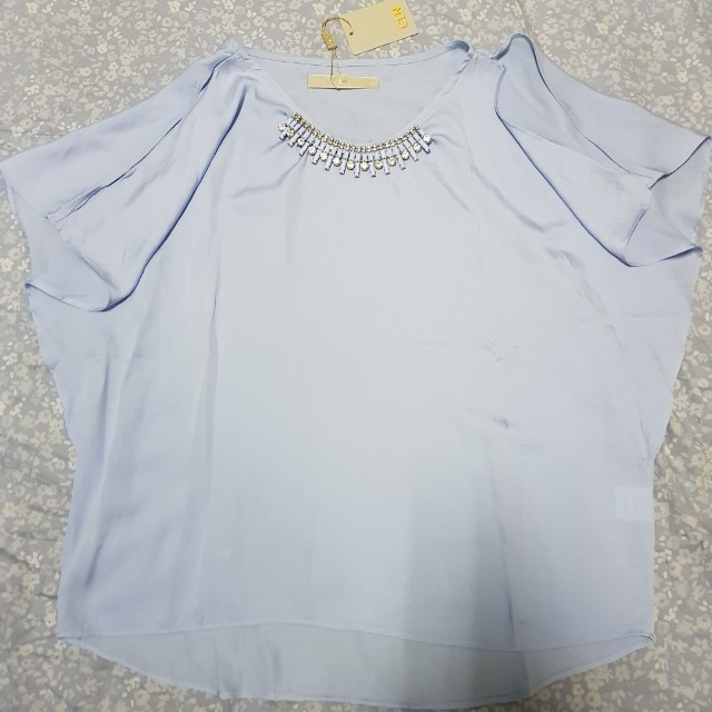 CLN light blue blouse with slits or cold shoulder