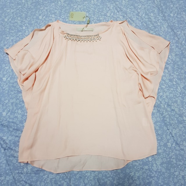 CLN Orange blouse with slit or cold shoulder