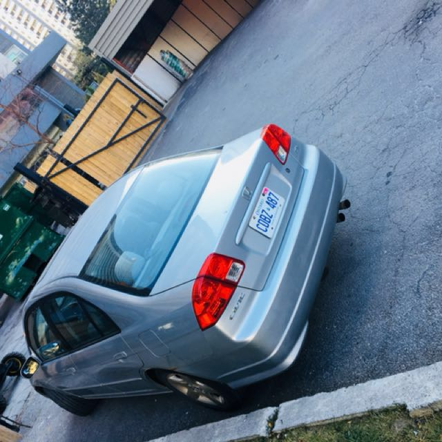 Honda civic sedan 2004 for sale with winter tires fixed price.Text me 4379896640