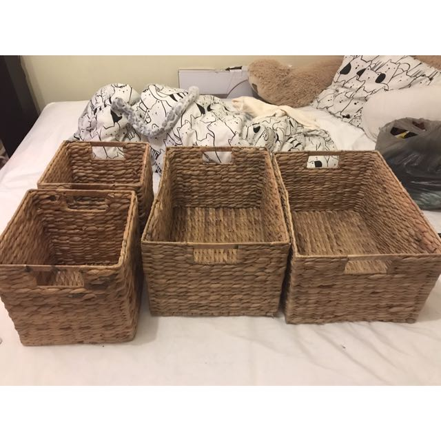 Two rectangle and two square woven storage baskets