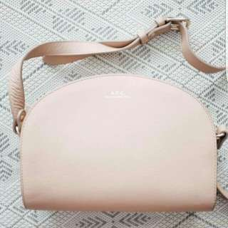 A.P.C half moon bag in blush pebbled leather