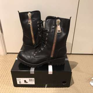 Black boots with large zip detail