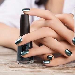 Dark green metallic nail polish