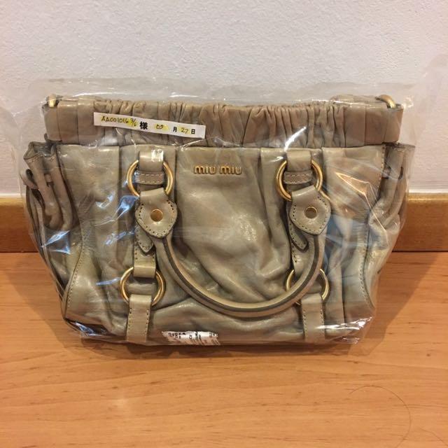 ee22cb235587 Authentic Mini Miu Miu Sling Bag