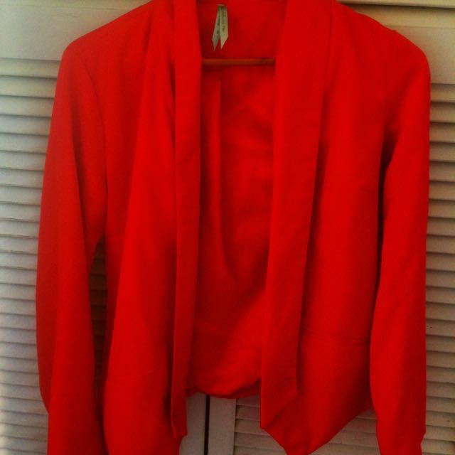 Woman's orange blazer size 8