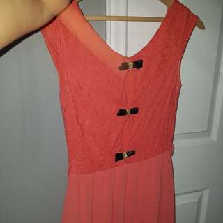Pink dress with bows at the back