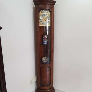 Corner display cabinet with clock.