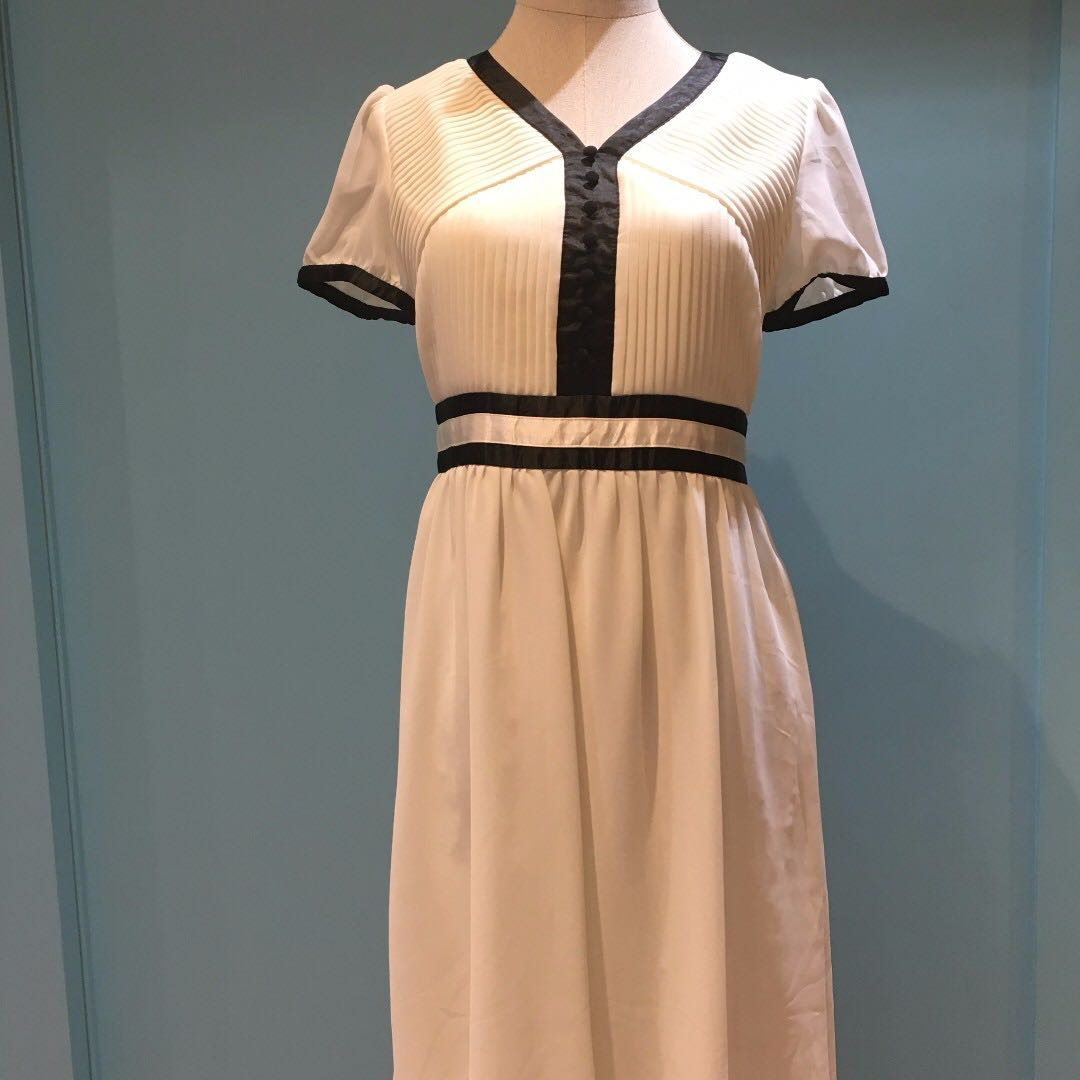 White Dress With Micro-Pleats and Black Contrast Piping