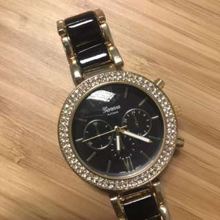 Geneva black gold watch