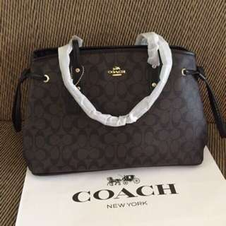 Coach signature carry