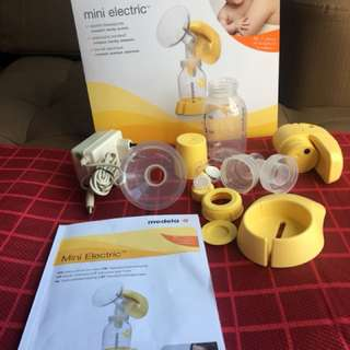Medela mini electric breast pump with free pigeon breast pads!