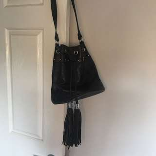 Pouch bag with tassels and shoulder strap