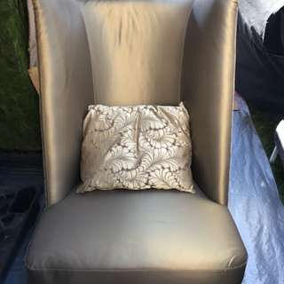 Gold colour wingback chair
