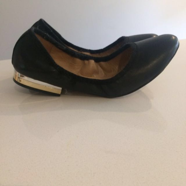 Black leather flats from Aldo