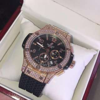 Hublot rose gold semi iced out with black band
