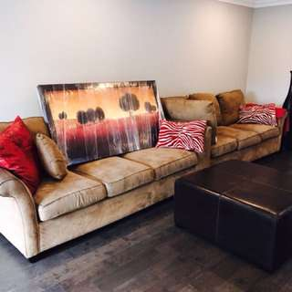 Sectional microfibre sofa, tree picture, ottoman and decorative vase