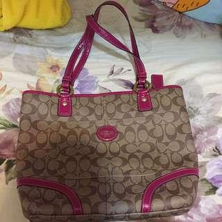Coach 粉紅色側孭袋