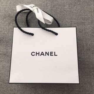 Chanel paper bag with ribbon