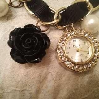 Beautiful charm bracelet with watch