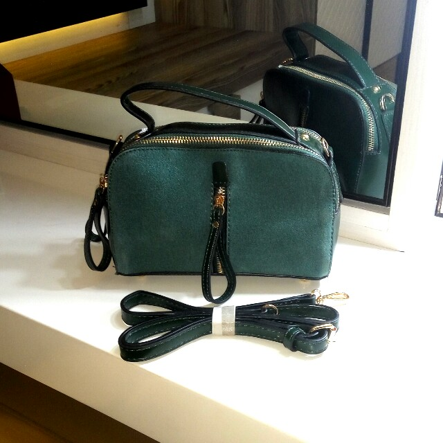 Women sling bag.  Emerald green.  Very elegant