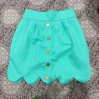 Green scallop skirt