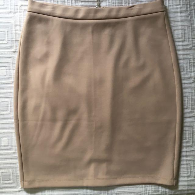 Beige/Nude mini skirt. Size M. WORN ONCE.