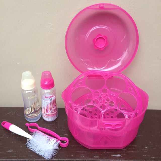 Pink bottle warmer with 2 juniors baby bottles