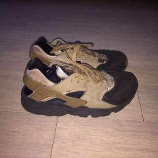 Black and brown Nike huaraches