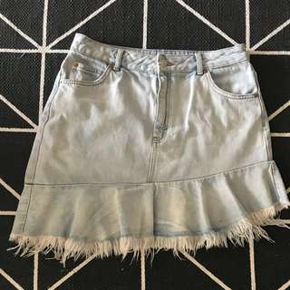 Top shop denim skirt. Asymmetric frayed hemline. Never worn but has not tags attached when bought. Size 14. Small fit would fit size 12