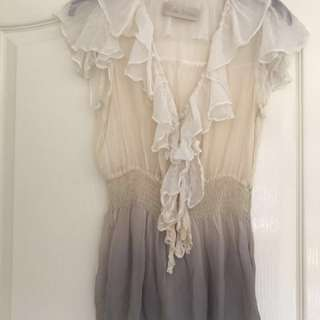 100% Silk river island top. Worn a few times. Size 8. Sheer style, cream colour fades to purple.
