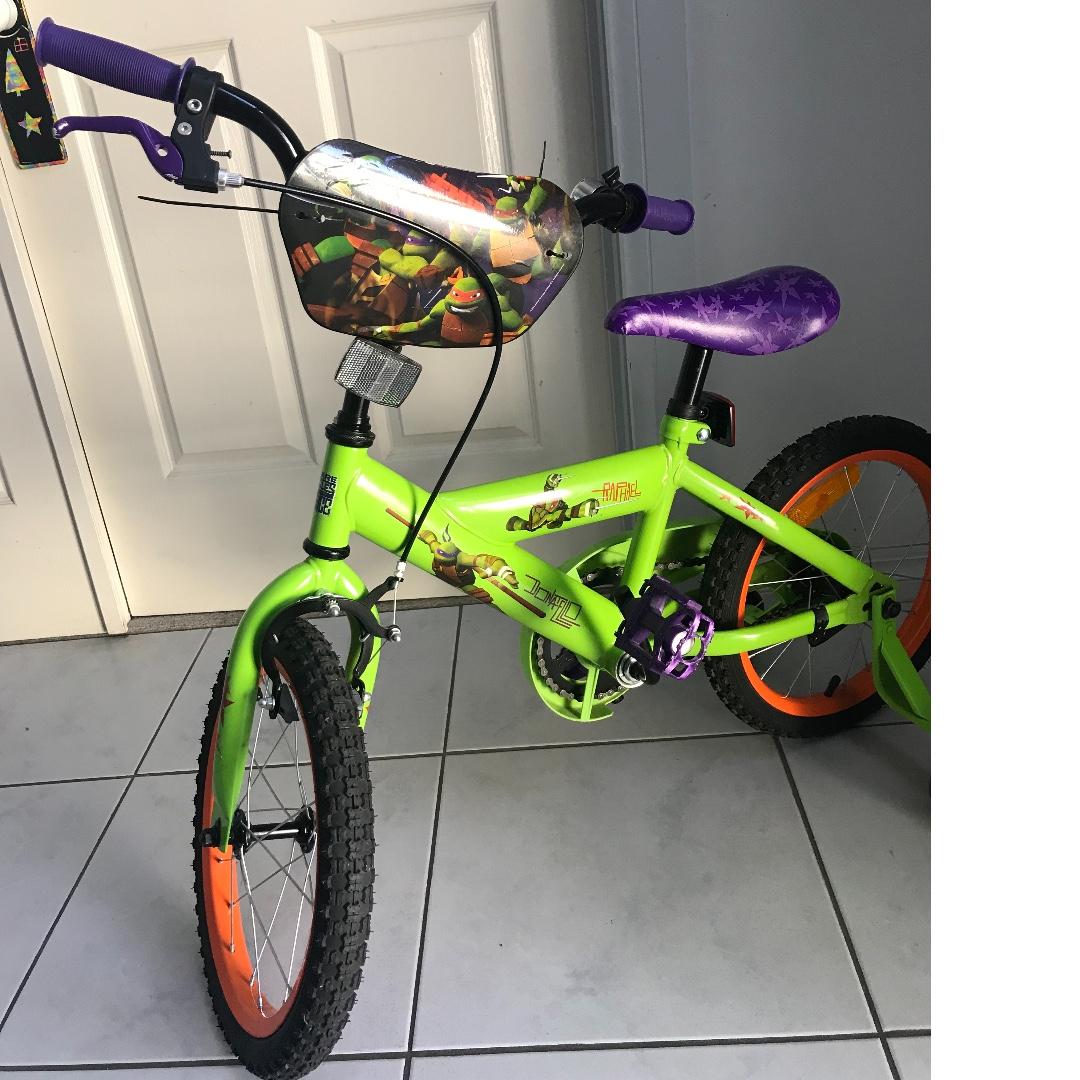 Ninja Turtles bicycle and Lightning McQueen helmet