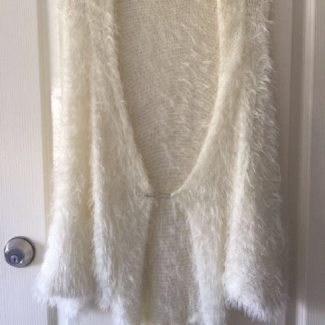 Oversized fluffy cardigan. Very light. Clasp at front is large safety pin. Never worn but tag removed.