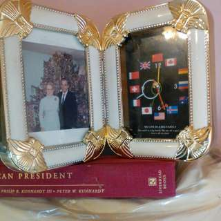 Picture frame with clock