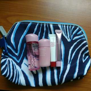 4 Shiseido travel size samples and an estee lauder cosmetics bag