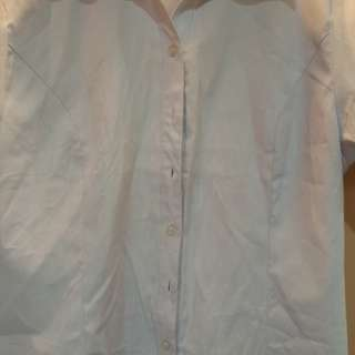 Selling womens formal top in light blue