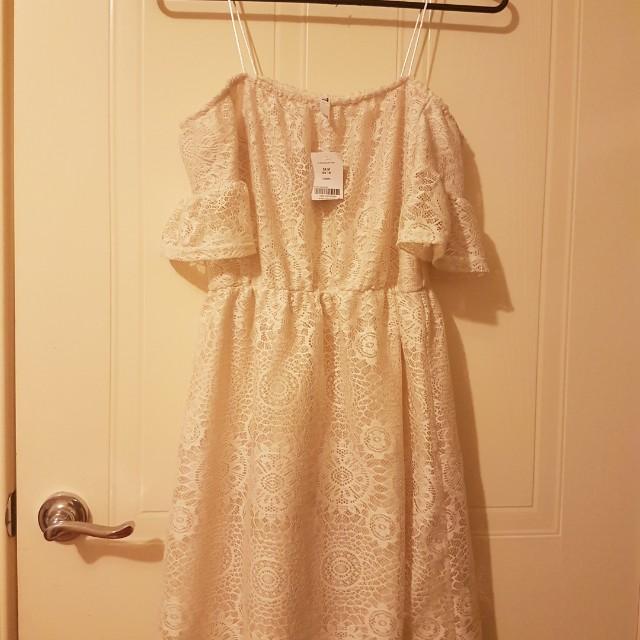 Brand new off shoulder cream dress