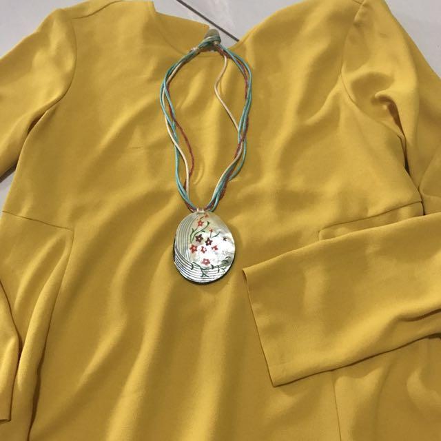 Kalung kerang warna warni