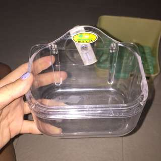 Clear pet hay tray or stand with screw at back to hook on cage
