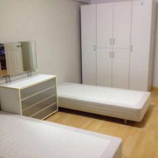 Spacious and breezy common room of corner unit for rent