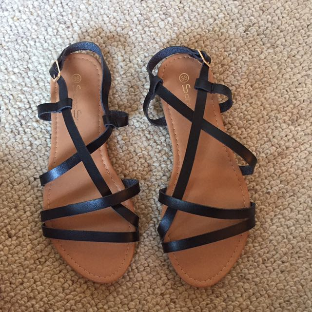 Brand new black strappy sandals