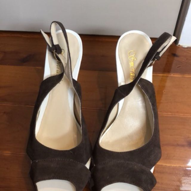 Brown and white smeraldo heels