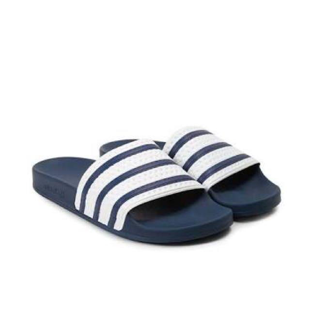 Blue adidas slides