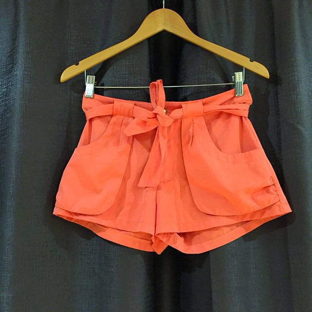 Orange high waisted shorts