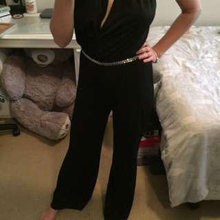 Guess jumpsuit black size 6-8
