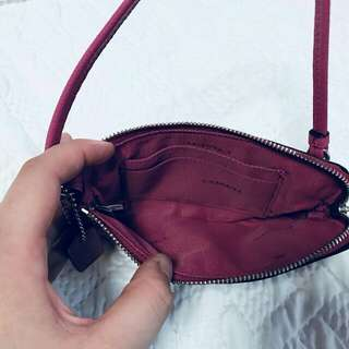 Authentic small coach pouch