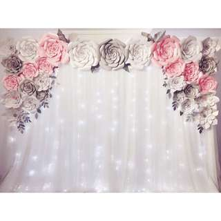 Paper flowers backdrop with fairy lights